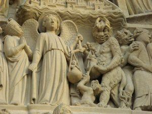 Statues_of_The_archangel_Michael_is_weighing_their_souls,_Notre-Dame_Cathedral,_Paris_19_February_2007